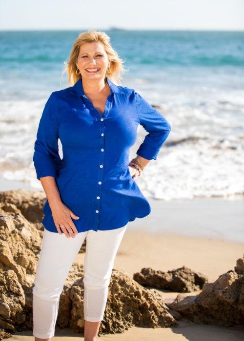 Ruth Lynch standing on a beach.